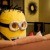Homemade minion costume sitting on the couch