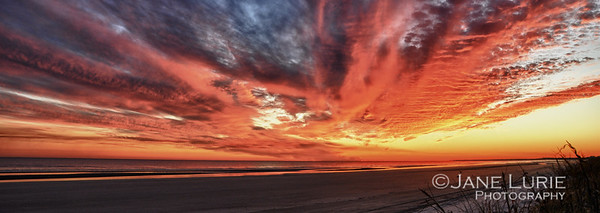 A stunning sunset lends to a long panoramic view of the beach. Kiawah Island, SC