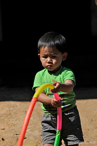 Little boy playing in a Hmong Village, Thailand.
