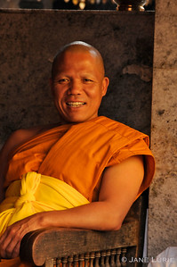 Happy and content. A monk relaxing in Chiang Mai, Thailand