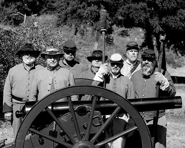 Reenactors with the 13th Battalion, North Carolina Light Artillery, D-Company pose for a shot behind a 10-pound Parrot canon at the 146th Anniversary of the Fall of Ft. Anderson in Brunswick Town, North Carolina on Sunday, February 20, 2011. Photo Copyright 2011 Jason Barnette