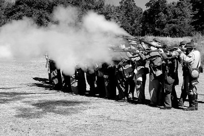 Reeanctors with the 18th, 20th, and 27th North Carolina Infantry demonstrate small arms fire at the 146th Anniversary of the Fall of Ft. Anderson in Brunswick Town, North Carolina on Sunday, February 20, 2011. Photo Copyright 2011 Jason Barnette