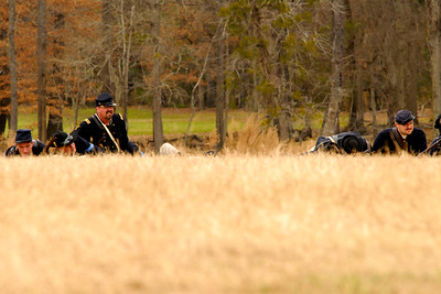 The Union infantry colonel peers over a small hill before giving commands on the field. The Skirmish at Gamble's Hotel happened on March 5, 1885 when 500 federal soldiers, under the command of Reuben Williams of the 12th Indiana Infantry, marched into Florence to destroy the railroad depot but were met by Confederate soldiers backed up with 400 militia. The reenactment, held by the 23rd South Carolina Infantry, was held at the Rankin Plantation in Florence, South Carolina on Saturday, March 5, 2011. Photo Copyright 2011 Jason Barnette