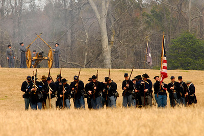 "Citadel reenactors mark an ""X"" with the worm and sponge to signify a misfire from a canon. The Skirmish at Gamble's Hotel happened on March 5, 1885 when 500 federal soldiers, under the command of Reuben Williams of the 12th Indiana Infantry, marched into Florence to destroy the railroad depot but were met by Confederate soldiers backed up with 400 militia. The reenactment, held by the 23rd South Carolina Infantry, was held at the Rankin Plantation in Florence, South Carolina on Saturday, March 5, 2011. Photo Copyright 2011 Jason Barnette"