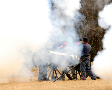 Smoke obscures a bronze Parrott Rifle. The Skirmish at Gamble's Hotel happened on March 5, 1885 when 500 federal soldiers, under the command of Reuben Williams of the 12th Indiana Infantry, marched into Florence to destroy the railroad depot but were met by Confederate soldiers backed up with 400 militia. The reenactment, held by the 23rd South Carolina Infantry, was held at the Rankin Plantation in Florence, South Carolina on Saturday, March 5, 2011. Photo Copyright 2011 Jason Barnette