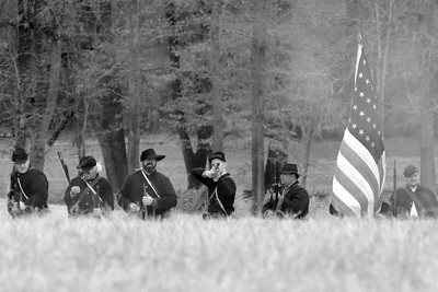 A lone Union infantry reenactor fires his rifle. The Skirmish at Gamble's Hotel happened on March 5, 1885 when 500 federal soldiers, under the command of Reuben Williams of the 12th Indiana Infantry, marched into Florence to destroy the railroad depot but were met by Confederate soldiers backed up with 400 militia. The reenactment, held by the 23rd South Carolina Infantry, was held at the Rankin Plantation in Florence, South Carolina on Saturday, March 5, 2011. Photo Copyright 2011 Jason Barnette