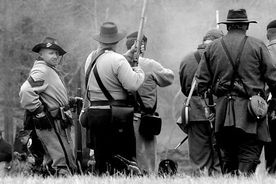 Union infantry reenactors and Confederate infantry reenactors face off against each other on the battlefield. The Skirmish at Gamble's Hotel happened on March 5, 1885 when 500 federal soldiers, under the command of Reuben Williams of the 12th Indiana Infantry, marched into Florence to destroy the railroad depot but were met by Confederate soldiers backed up with 400 militia. The reenactment, held by the 23rd South Carolina Infantry, was held at the Rankin Plantation in Florence, South Carolina on Saturday, March 5, 2011. Photo Copyright 2011 Jason Barnette