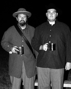 A father/son reenactor duo poses for a shot in their camp. The Skirmish at Gamble's Hotel happened on March 5, 1885 when 500 federal soldiers, under the command of Reuben Williams of the 12th Indiana Infantry, marched into Florence to destroy the railroad depot but were met by Confederate soldiers backed up with 400 militia. The reenactment, held by the 23rd South Carolina Infantry, was held at the Rankin Plantation in Florence, South Carolina on Saturday, March 5, 2011. Photo Copyright 2011 Jason Barnette