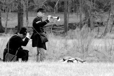 "The bugler plays a song to honor the ""fallen"" reenactors on the field at the conclusion of the battle. The Skirmish at Gamble's Hotel happened on March 5, 1885 when 500 federal soldiers, under the command of Reuben Williams of the 12th Indiana Infantry, marched into Florence to destroy the railroad depot but were met by Confederate soldiers backed up with 400 militia. The reenactment, held by the 23rd South Carolina Infantry, was held at the Rankin Plantation in Florence, South Carolina on Saturday, March 5, 2011. Photo Copyright 2011 Jason Barnette"