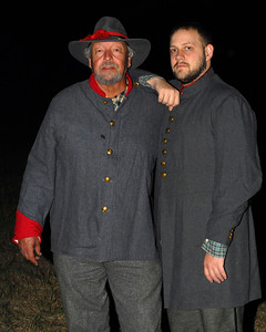 A reenactor, dressed in a Confederate uniform, poses with his son, dressed in civilian clothing and a Confederate jacket. The Skirmish at Gamble's Hotel happened on March 5, 1885 when 500 federal soldiers, under the command of Reuben Williams of the 12th Indiana Infantry, marched into Florence to destroy the railroad depot but were met by Confederate soldiers backed up with 400 militia. The reenactment, held by the 23rd South Carolina Infantry, was held at the Rankin Plantation in Florence, South Carolina on Saturday, March 5, 2011. Photo Copyright 2011 Jason Barnette