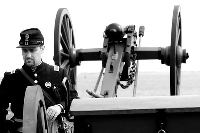 A major stands behind a canon facing out over Charleston Harbor at Patriots Point in Mt. Pleasant, South Carolina on Sunday, April 10, 2011. ..The 150th Anniversary of the Firing on Ft. Sumter was commemorated with lectures, performances, demonstrations, and a living history throughout the area on James Island, Charleston, Mt. Pleasant, and Sullivan's Island during the week from April 8-14, 2011. Photo Copyright 2011 Jason Barnette