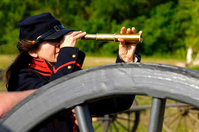 Elizabeth Wolf uses a small spyglass to view Ft. Sumter from Patriots Point in Mt. Pleasant, South Carolina on Sunday, April 10, 2011. ..The 150th Anniversary of the Firing on Ft. Sumter was commemorated with lectures, performances, demonstrations, and a living history throughout the area on James Island, Charleston, Mt. Pleasant, and Sullivan's Island during the week from April 8-14, 2011. Photo Copyright 2011 Jason Barnette