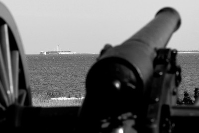 An artillery battery sits poised for action with Ft. Sumter along the horizon at Patriots Point in Mt. Pleasant, South Carolina on Sunday, April 10, 2011. ..The 150th Anniversary of the Firing on Ft. Sumter was commemorated with lectures, performances, demonstrations, and a living history throughout the area on James Island, Charleston, Mt. Pleasant, and Sullivan's Island during the week from April 8-14, 2011. Photo Copyright 2011 Jason Barnette