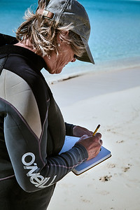 Barbara taking notes on the turtle's biometrics