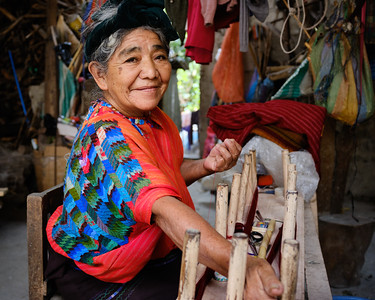 A Mayan woman warping thread for clothing in Jaibalito, Guatemala