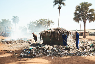 Garbage collection and burning in the outskirts of Jinja.  Most of the trash produced will never end up in a collection spot like this - it will just stay wherever its tossed.  Garbage that is collected is usually burned because there aren't any better ways to dispose of it.  There is a recycling program, but it's in its youth and isn't practiced.