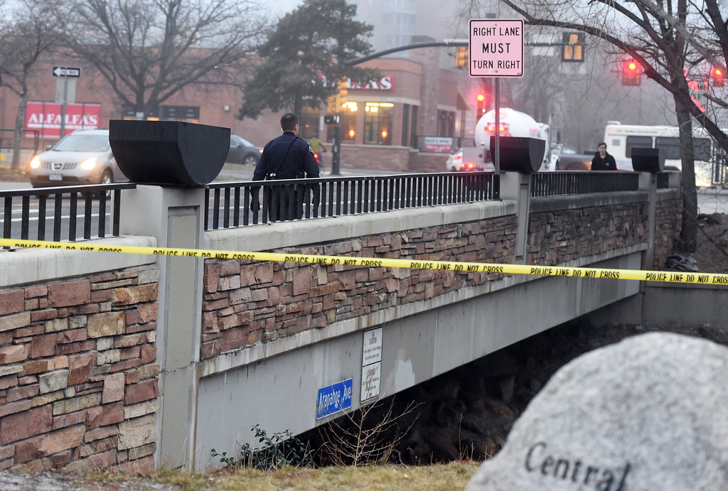 . Police investigate the area at Boulder Creek and Arapahoe Avenue where a man was found. The man has been taken to the hospital after he was found face-down and not moving in Boulder Creek this morning. Cliff Grassmick  Photographer  February 9, 2018
