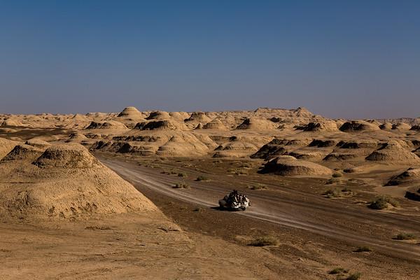 A pickup truck filled with Afghans leaving for neighbouring Iran makes its way through the unforgiving landscape of Nimruz.<br /> <br /> Nimruz, August 2016<br /> <br /> NRC/Jim Huylebroek