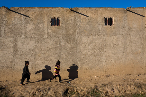 Children play in the streets of Takhali Khana, an area of Maimana, Faryab, in northern Afghanistan, mainly inhabited by IDPs.<br /> <br /> Faryab, January 2017<br /> <br /> NRC/Jim Huylebroek
