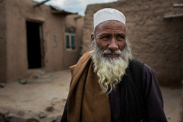 Ghulam Sarwar, originally from Kushk, a district in Herat, in front of his home in the Shaedayee settlement for IDPs in Herat city, Afghanistan.<br /> <br /> Herat, May 2017<br /> <br /> Photo NRC/Jim Huylebroek