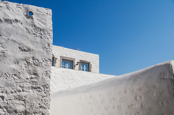Greek Blue & White / white walls, blue windows and blue sky in Patmos, Greece