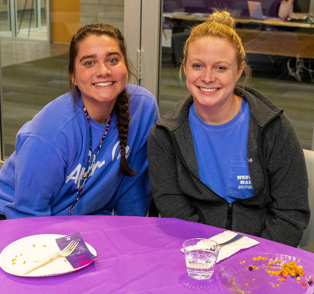 On Sunday, Nov. 11, Allison Arrendondo (left) and Emily Francis (right) enjoyed a dinner together at the Unthanksgiving event presented by the Department of Housing and Dining Services' Social Justice Alliance. The dinner educated residents about relevant issues in diversity and multiculturalism by celebrating indigenous peoples of America as well as having them participate in a hunger banquet. (Brooke Barrett   Collegian Media Group)