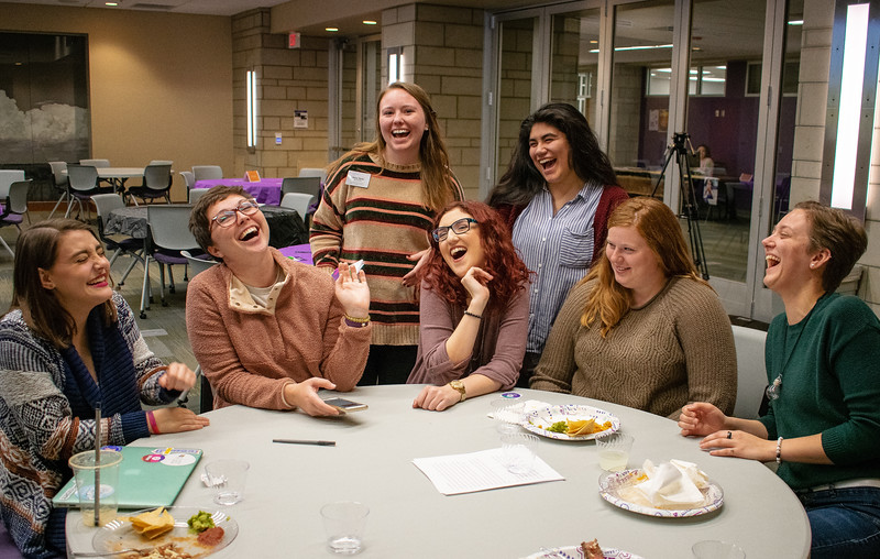 Marley Lowe, Holly Gerke, Ashley Arnold, Emily Carroll, Mary White (front row left to right), Anna Taylor, and Jacquii Ayala-Cruz (back row left to right) enjoy spending time together at the Unthanksgiving dinner hosted by the Department of Housing and Dining Services' Social Justice Alliance from 5-6:30 p.m. in the Kramer Tallgrass Ballroom. This event educated residents about relevant issues in diversity and multiculturalism by celebrating indigenous peoples of America as well as having them participate in a hunger banquet. (Brooke Barrett | Collegian Media Group)