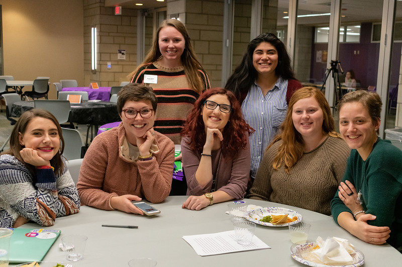 Marley Lowe, Holly Gerke, Ashley Arnold, Emily Carroll, Mary White (front row left to right), Anna Taylor, and Jacquii Ayala-Cruz (back row left to right) enjoy spending time together at the Unthanksgiving dinner hosted by the Department of Housing and Dining Services' Social Justice Alliance from 5-6:30 p.m. in the Kramer Tallgrass Ballroom. This event raised awareness to residents about relevant issues in diversity and multiculturalism by celebrating indigenous peoples of America as well as having them participate in a hunger banquet. (Brooke Barrett | Collegian Media Group)