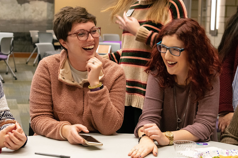 Holly Gerke (left) and Ashley Arnold (right) share laughs together at the Unthanksgiving hunger banquet on Nov. 11 in the Kramer Tallgrass Ballroom. This event raised awareness of issues in diversity and multiculturalism by celebrating indigenous peoples of America as well as having students participate in a hunger banquet. (Brooke Barrett | Collegian Media Group)