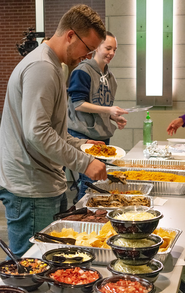 Cody Hopkins, a senior in park management and conservation, participates in the Unthanksgiving celebration put on by the Department of Housing and Dining Services' Social Justice Alliance. This event took place in the Kramer Tallgrass Ballroom from 5-6:30 p.m. on Nov. 11. (Brooke Barrett | Collegian Media Group)