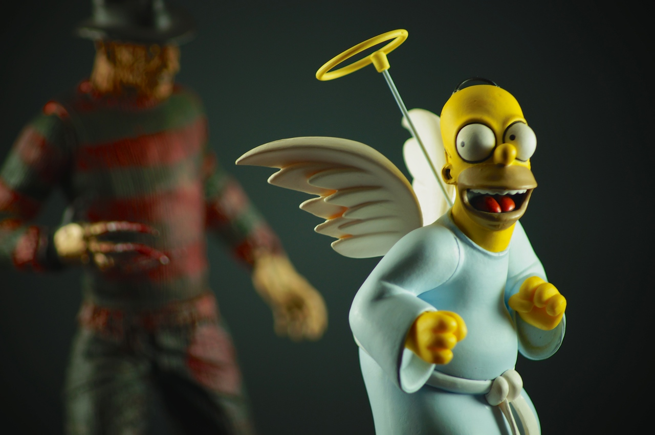 Angel Homer Simpson has nothing to fear, even with Freddy lurking behind.