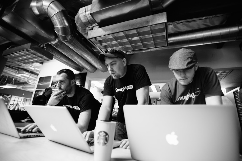 Launch Day, 9:10am. The Quality Assurance Team reviews a list of bug fixes. Things are looking good. Pictured L-R: Eric Petruno, Quality Assurance Tester Chris Skopec, Evan Deffley.