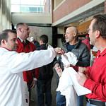 Nathan Huser handed a t-shirt to Joe Huber.