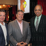 Senior Associate Athletic Director for Development Mark Zurich, Vice President/Director of Athletics Tom Zurich and Dr. Neville Pinto.