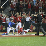 Colin Lyman slid under the tag by UK\'s catcher Troy Squires and scored the winning run. The crowd was celebrating as the umpire signaled safe.