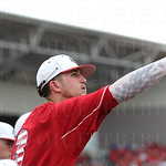 U of L player Ryan Summers motioned for the Card\'s right fielder to move more toward the foul line.