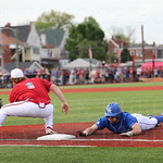UK\'s Luke Becker dove head first back to first to avoid being picked off in the top of the 4th inning. Danny Rosenbaum awaited the pickoff throw.