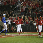 In the bottom of the 8th inning the Card\'s Danny Rosenbaum scored on a wild pitch by UK\'s Sean Hjelle to tie the score at 6 apiece.