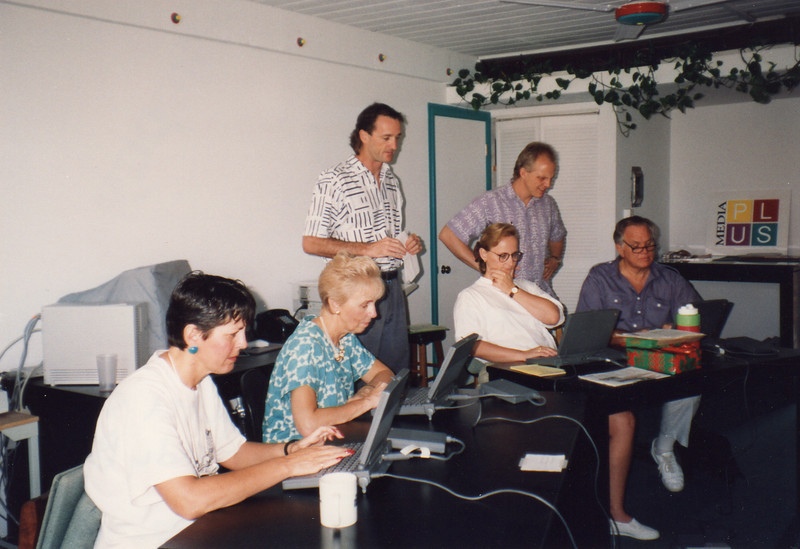 Landa Cope, Loren, Darlene, Dawn Gauslin being taught computer skills by Kevin Norris and Andy Beach