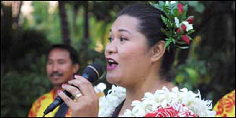 Island Breeze member June Mataia at luau at King Kamehameha Beach hotel