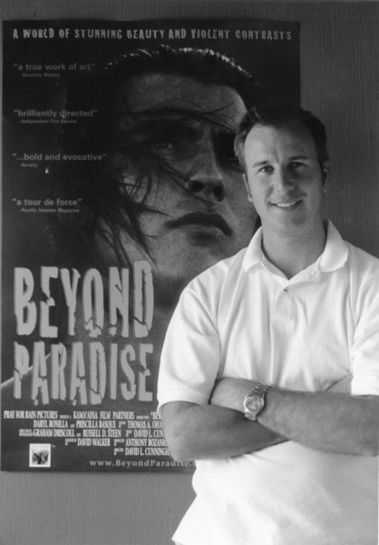 David Cunningham w/poster of first movie, Beyond Paradise