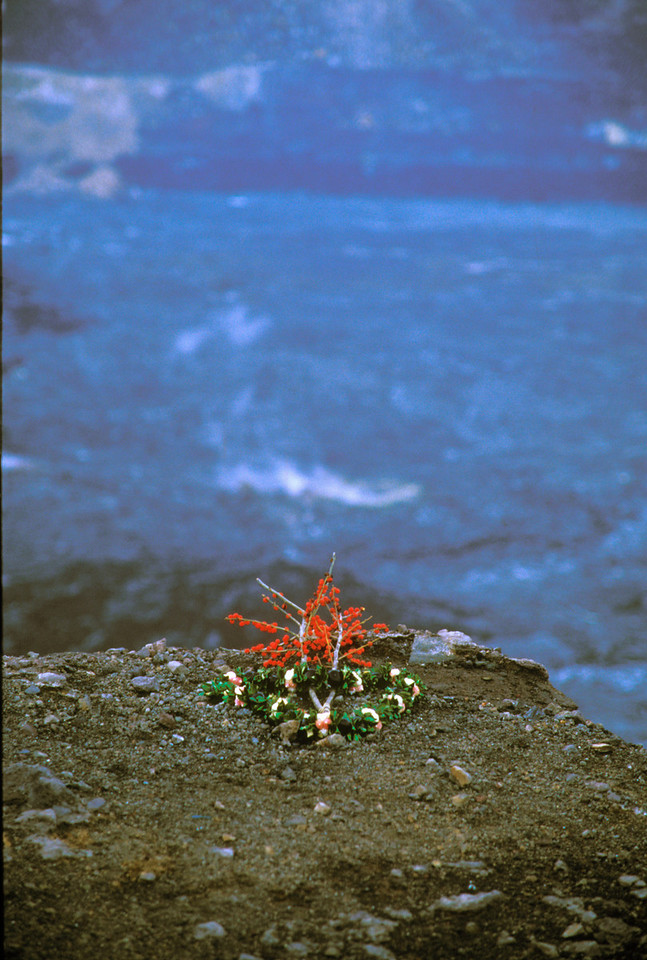 Flower offering left for the goddess Pele at edge of Halemaumau caldera at Kilauea volcano