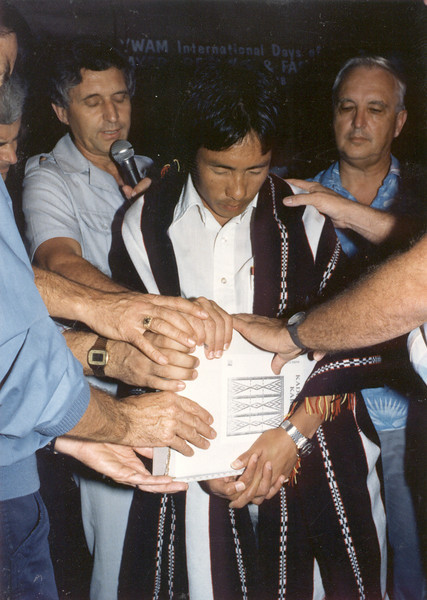 Man from Nagaland being prayed over-first Bible in their language. <br /> Bruce T - Stan S