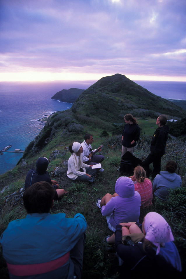 SOW outreach students worship on top of a mountain and pray for the island of Oahu and Hawaii.  2/03