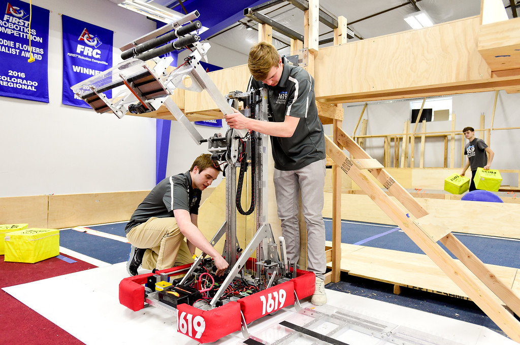 . Niwot High School Senior Zach Olkin, left, and Junior Andrew Arnold, right, break down their competition winning robot after a demonstration at the Up-A-Creek Robotics practice and engineering facility in Longmont, Colorado on May 8, 2018. (Photo by Matthew Jonas/Staff Photographer)