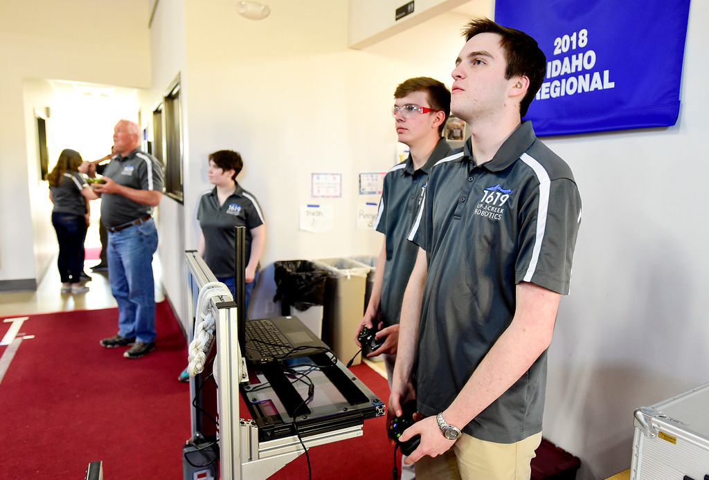 . Niwot High School Senior Zach Olkin, right, and Junior Andrew Arnold, left, demonstrate their competition winning robot at the Up-A-Creek practice and engineering facility in Longmont, Colorado on May 8, 2018. (Photo by Matthew Jonas/Staff Photographer)
