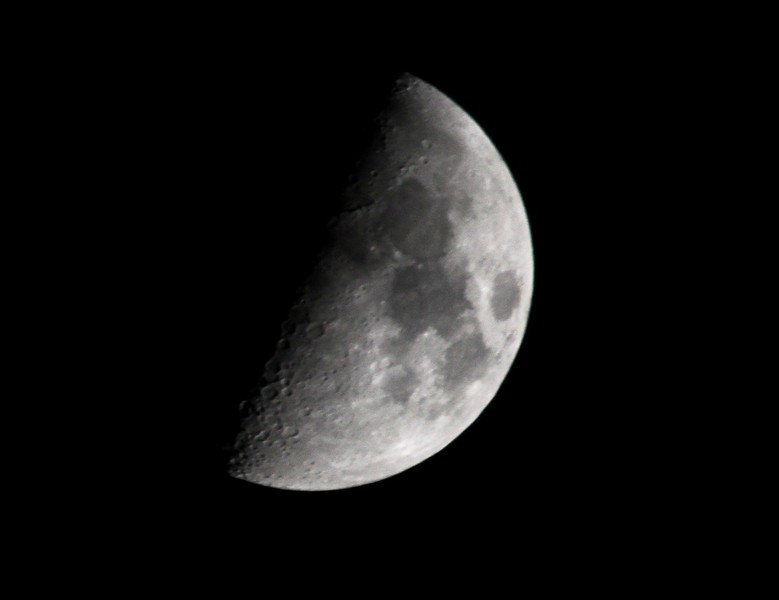 Quarter Moon - 21Apr2010  (was a bit to lazy to set up the tripod, so pic is a bit on the blurry side, image stabilization on the lens can only do so much).<br /> Why is it called a quarter moon when it looks like 1/2 a full moon?
