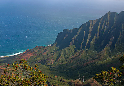 A heavily eroded ridgeline of the Napali Coast that extends downslope from Kalalau Lookout down to the shoreline, Kalalau Valley near Waimea Canyon, north Kaua'i.