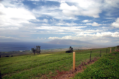 West Maui Mountains on the hazy horizon. Lana'i can be seen on the distant horizon, left side of photo. Shot taken from the roadbed of the Kula Highway, near Ulupalakua Ranch, south Maui.