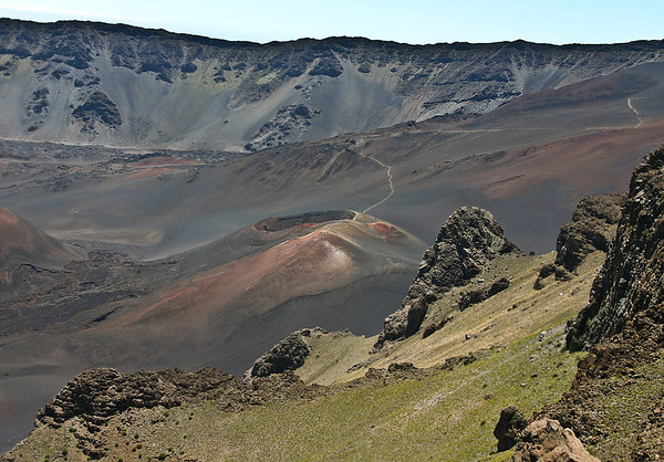 The view into Haleakala's summit basin from Kalahaku Overlook. The Sliding Sands Trail that leads down into the summit basin snakes uphill behind one of the recently-erupted cinder cones.